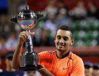 Tennis - Japan Open men's Singles Final Match - Ariake Coliseum, Tokyo, Japan - 09/10/16. Nick Kyrgios of Australia poses with his victory trophy. REUTERS/Kim Kyung-Hoon