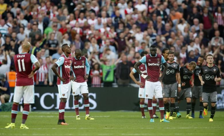 Britain Football Soccer - West Ham United v Southampton - Premier League - London Stadium - 25/9/16West Ham players look dejected after Southampton's James Ward-Prowse scored their third goal Action Images via Reuters / Matthew Childs