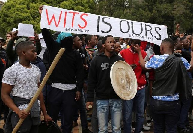 Students chant slogans during clashes with the South African police at Johannesburg's University of the Witwatersrand, South Africa, October 4, 2016. REUTERS/Siphiwe Sibeko
