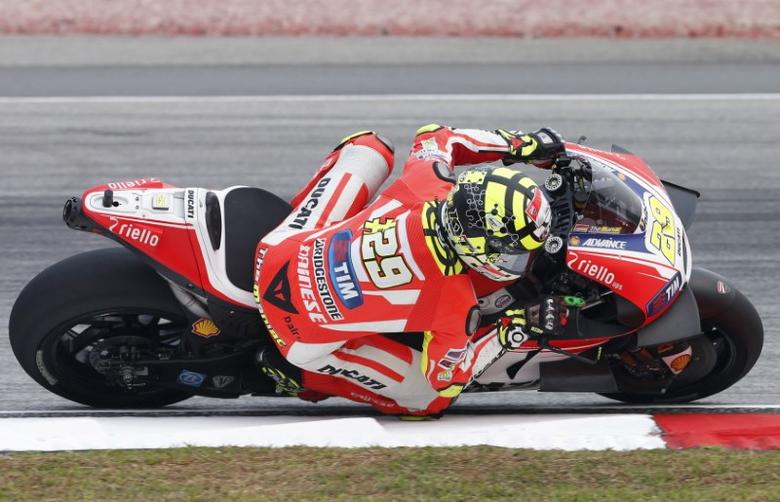 Ducati MotoGP rider Andrea Iannone of Italy rides during the first free practice session of the Malaysian Motorcycle Grand Prix at Sepang International Circuit near Kuala Lumpur, Malaysia, October 23, 2015. REUTERS/Olivia Harris