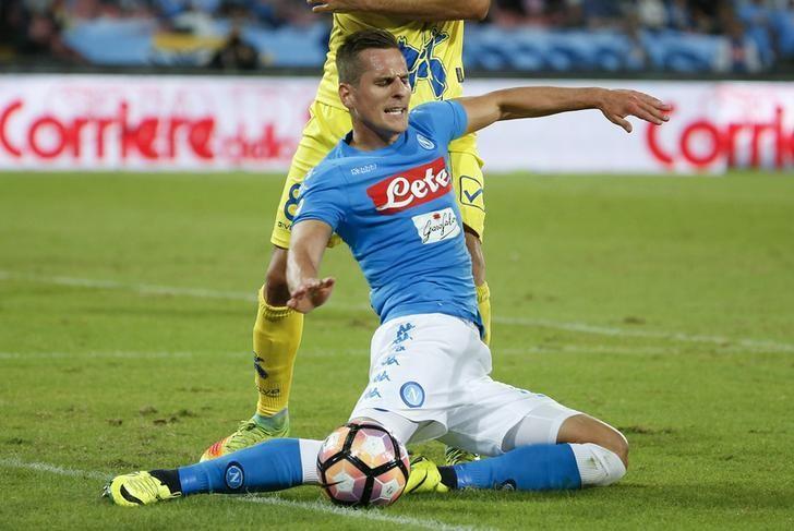 Football Soccer - Napoli v Chievo - Italian Serie A - San Paolo stadium, Naples, Italy - 24/9/2016. Napoli's Arkadiusz Milik in action against Chievo's Ivan Radovanovic. REUTERS/Ciro De Luca