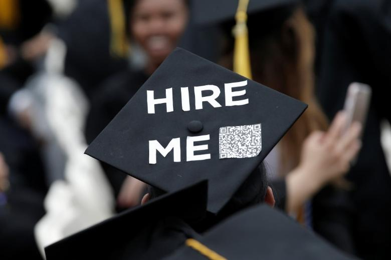 A graduating student of the City College of New York wears a message on his cap during the College's commencement ceremony in the Harlem section of Manhattan, New York, U.S., June 3, 2016. REUTERS/Mike Segar