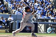 Washington Nationals third baseman Anthony Rendon (6) hits a two run home run during the third inning against the Los Angeles Dodgers in game three of the 2016 NLDS playoff baseball series at Dodger Stadium. Mandatory Credit: Richard Mackson-USA TODAY Sports
