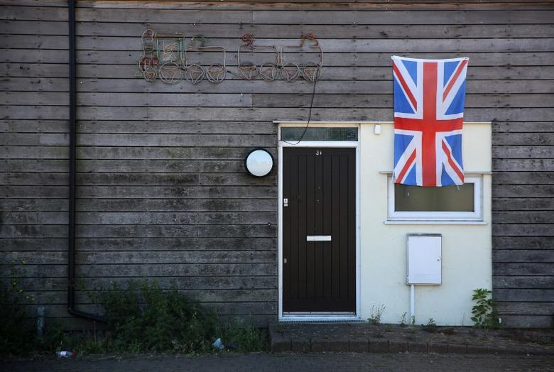 A union flag is displayed on a house at Jaywick near Clacton-on-Sea, a town in eastern England, where 70 percent of people voted on June 23, 2016 to leave the European Union, Britain August 23, 2016. REUTERS/Neil Hall