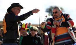 Competitors swing their conkers during a match at the World Conker Championships, in Southwick, central England October 9, 2016. REUTERS/Phil Noble