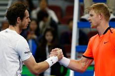 Tennis - China Open Men's Singles quarterfinal - Beijing, China - 07/10/16. Britain's Andy Murray shakes hands with his compatriot Kyle Edmund after their match.  REUTERS/Thomas Peter