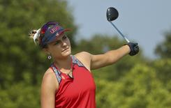 2016 Rio Olympics - Golf - Preliminary - Women's Individual Stroke Play - Olympic Golf Course - Rio de Janeiro, Brazil - 19/08/2016.  Lexi Thompson (USA) of the United States reacts after her tee shot on the fifth hole during third round women's Olympic golf competition.   REUTERS/Andrew Boyers