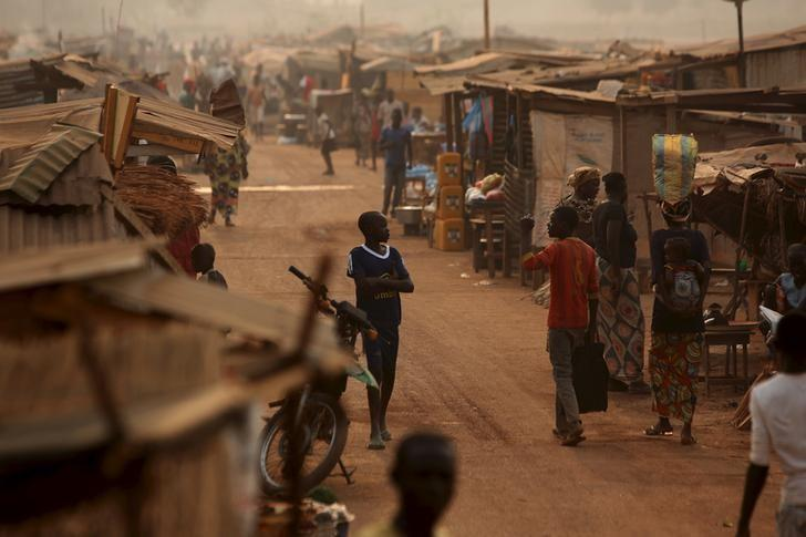 A boy walks in a camp sheltering internally displaced people (IDPs) next to the M'Poko international airport in Bangui, Central African Republic, February 13, 2016. REUTERS/Siegfried Modola