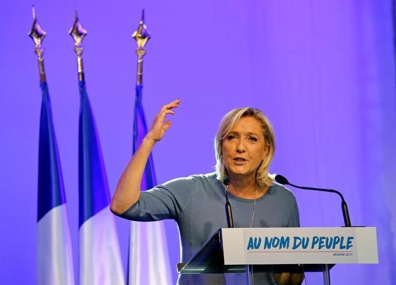 French National Front (FN) political party leader Marine Le Pen delivers a speech during a FN political rally in Frejus, France September 18, 2016. REUTERS/Jean-Paul Pelissier