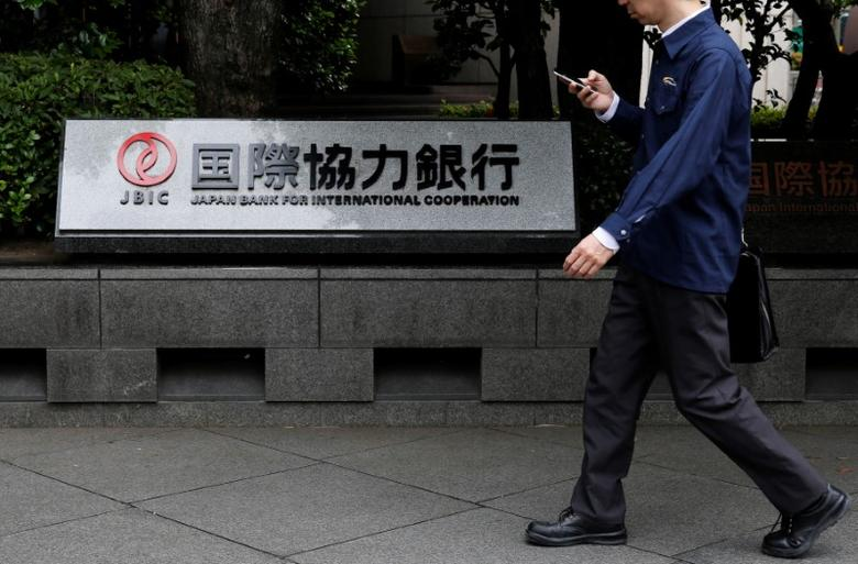 A man walks past a sign of Japan Bank for International Cooperation (JBIC) at it's headquarters in Tokyo, Japan June 6, 2016.  REUTERS/Toru Hanai