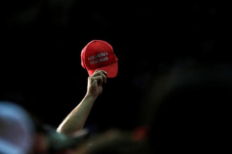 A supporter waves a hat while Republican presidential nominee Donald Trump speaks at a campaign event in Winston-Salem, North Carolina, U.S., July 25, 2016.  REUTERS/Carlo Allegri