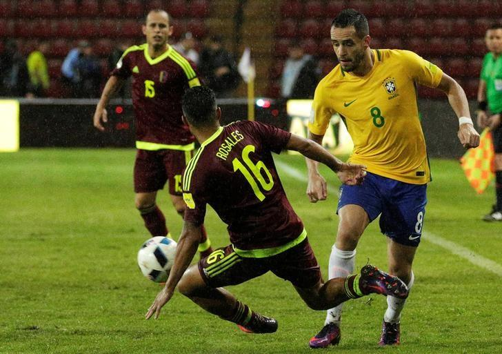 Football Soccer - Venezuela v Brazil - World Cup 2018 Qualifiers - Metropolitano Stadium, Merida, Venezuela - 11/10/16 - Brazil's Renato Augusto (R) and Venezuela's Roberto Rosales in action. REUTERS/Marco Bello