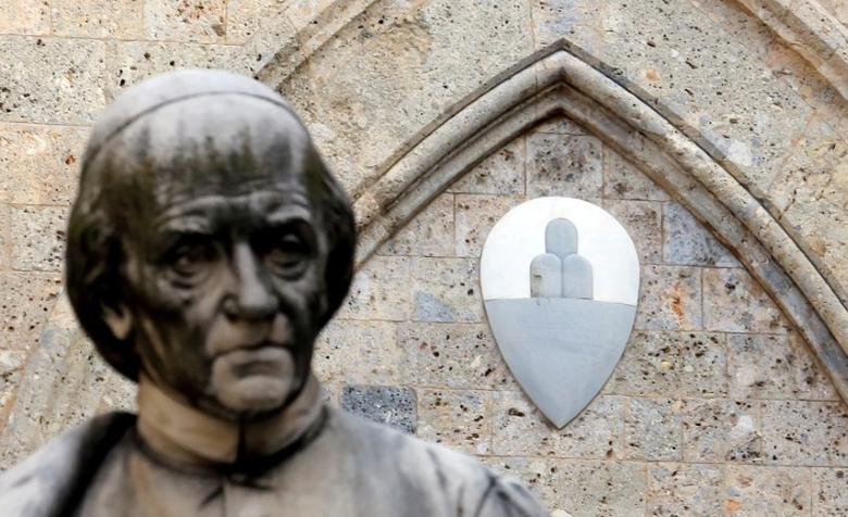 The Monte dei Paschi di Siena bank logo is pictured at the bank's headquarters in Siena, Italy January 25, 2013. REUTERS/Stefano Rellandini/File Photo
