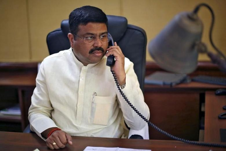 India's Oil Minister Dharmendra Pradhan speaks on phone during an interview with Reuters in New Delhi, India, May 5, 2016. REUTERS/Adnan Abidi/Files