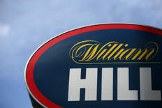 A branded sign is displayed outside a William Hill betting shop in London, Britain July 25, 2016. REUTERS/Neil Hall
