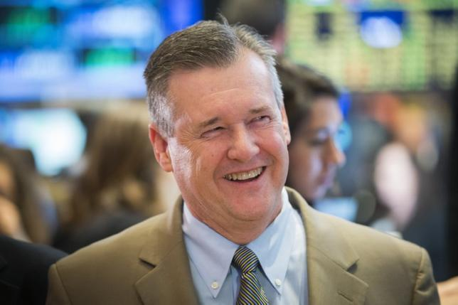 Chief executive officer of Hershey, John P. Bilbrey, smiles as he stands on the floor of the New York Stock Exchange in New York October 31, 2014. REUTERS/Lucas Jackson