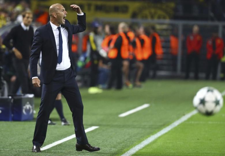 Football Soccer - Borussia Dortmund v Real Madrid - UEFA Champions League group stage - Group F - Signal Iduna Park stadium, Dortmund, Germany - 27/09/16 - Real Madrid's coach Zinedine Zidane reacts   REUTERS/Kai Pfaffenbach