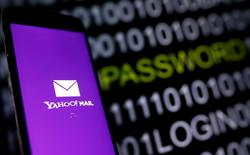 Yahoo Mail logo is displayed on a smartphone's screen in front of a code in this illustration taken in October 6, 2016. REUTERS/Dado Ruvic