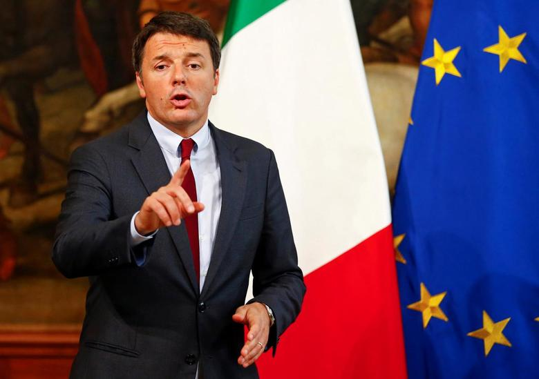 Italian Prime Minister Matteo Renzi gestures as he talks during a news conference at Chigi Palace in Rome, Italy October 12, 2016. REUTERS/Tony Gentile