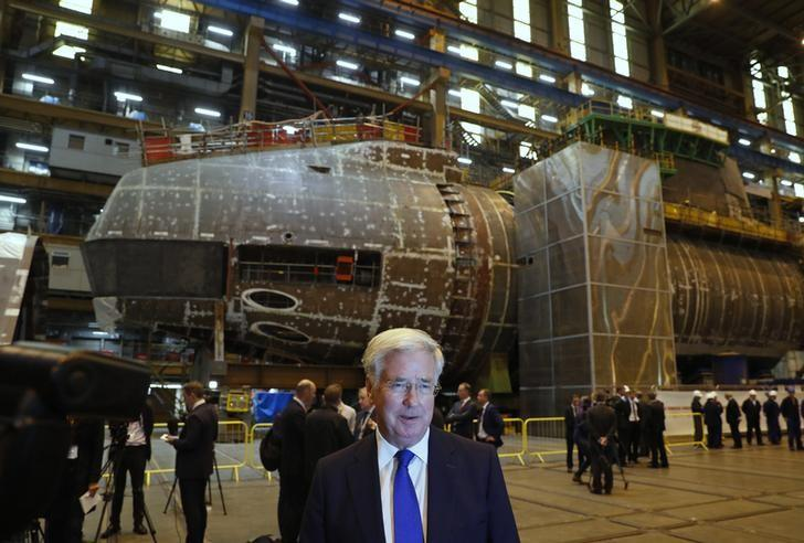 Britain's Defence Secretary Michael Fallon stands in front of HMS Anson, under construction, at BAE Systems in Barrow-In-Furness, Britain October 5, 2016. REUTERS/Phil Noble