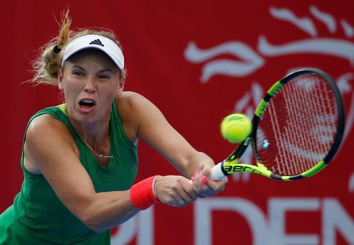 Tennis - Hong Kong Open final - Caroline Wozniacki of Denmark v Kristina Mladenovic of France - Hong Kong, China - 16/10/16. Wozniacki returns a shot.  REUTERS/Bobby Yip