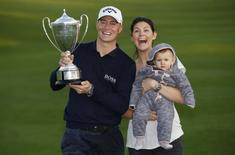 Britain Golf - British Masters - The Grove, Hertfordshire - 16/10/16 Sweden's Alex Noren celebrates winning the British Masters with his wife Jennifer Kovacs and child Action Images via Reuters / Paul Childs Livepic EDITORIAL USE ONLY.