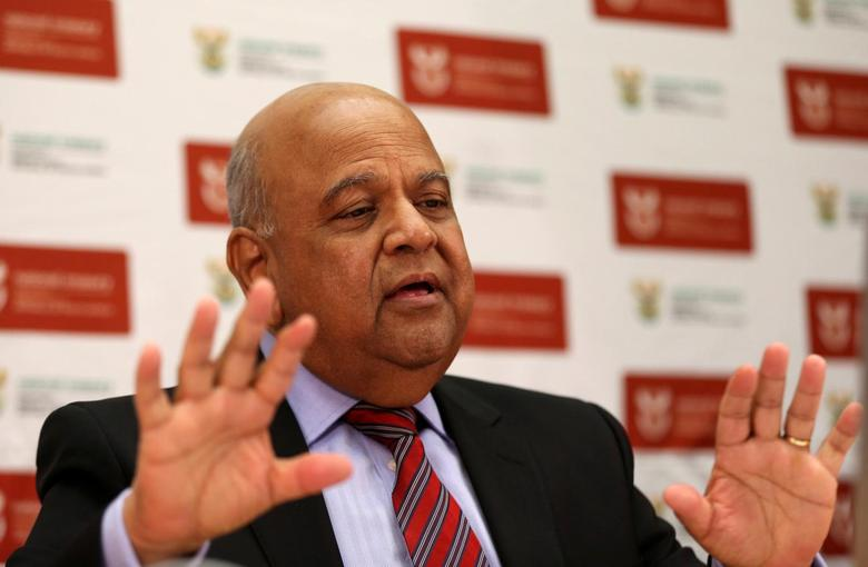 South African finance minister Pravin Gordhan gestures in his office in Pretoria, as he speaks via video link to a Thomson Reuters investment conference in Cape Town South Africa, October 14,2016. REUTERS/Siphiwe Sibeko