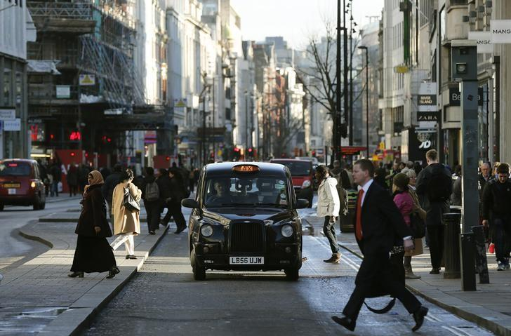 A taxi travels along Oxford Street during a bus strike in London January 13, 2015. Members of the Unite union are staging a 24-hour bus strike over pay and conditions, local media reported.  REUTERS/Suzanne Plunkett