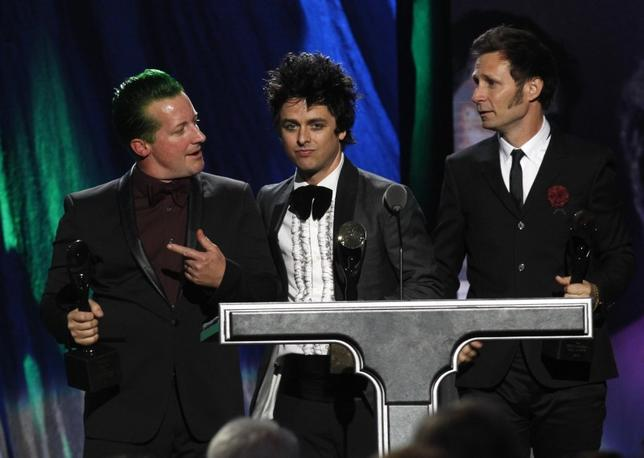 Members of the band Green Day react as they are inducted during the 2015 Rock and Roll Hall of Fame Induction Ceremony in Cleveland, Ohio April 18, 2015. REUTERS/Aaron Josefczyk