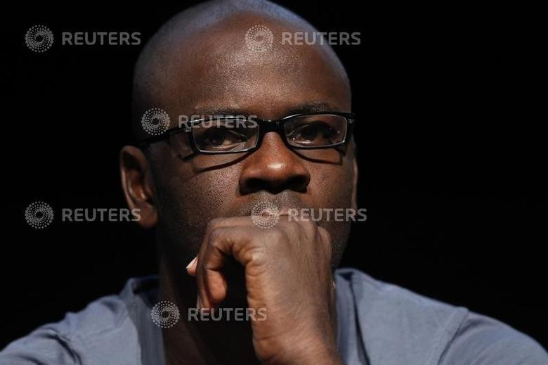 Former French soccer player Lilian Thuram attends a news conference for ''A call for a multicultural and postracial Republic'' in Paris January 20, 2010.  REUTERS/Benoit Tessier