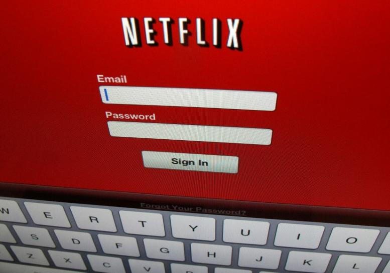 Netflix subscriptions boom around world, shares jump 20 percent | Reuters