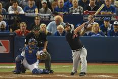 Oct 17, 2016; Toronto, Ontario, CAN; Cleveland Indians first baseman Mike Napoli (right) hits a solo home run in front of Toronto Blue Jays catcher Russell Martin (left) during the fourth inning in game three of the 2016 ALCS playoff baseball series at Rogers Centre. Mandatory Credit: Dan Hamilton-USA TODAY Sports