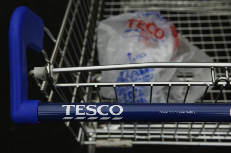 A discarded carrier bag is seen in a shopping trolley outside a Tesco supermarket in London January 5, 2015. REUTERS/Luke MacGregor