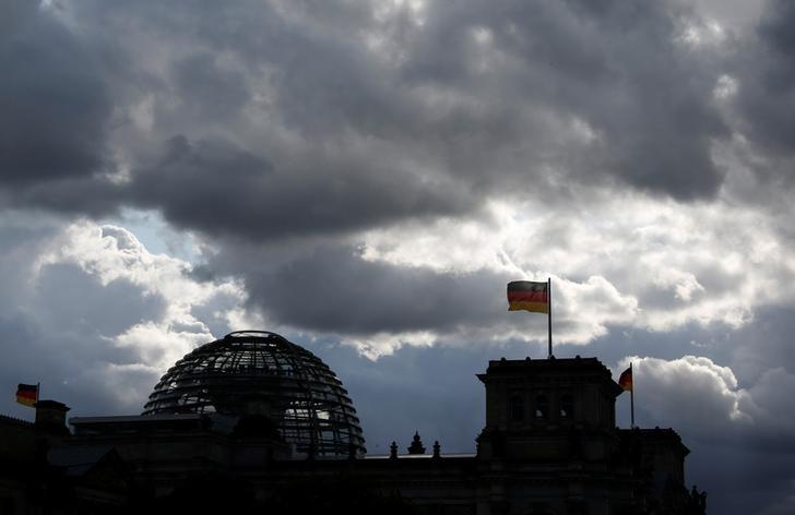 The Reichstag building, the seat of the lower house of parliament Bundestag is silhouetted against a dark cloudy sky in Berlin, Germany, May 15, 2016.    REUTERS/Fabrizio Bensch
