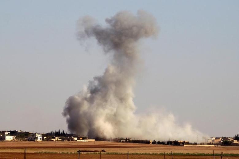 Smoke rises from airstrikes on Guzhe village, northern Aleppo countryside, Syria October 17, 2016. REUTERS/Khalil Ashawi