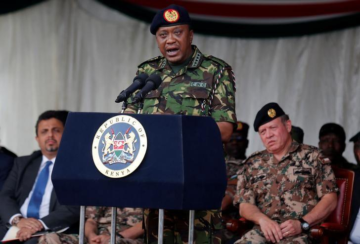 Kenya's President Uhuru Kenyatta addresses soldiers after joint military exercises dubbed Swift Eagle conducted by the Kenya Defence Forces (KDF) and the Royal Jordanian Armed Forces at the Embakasi Garrison Humanitarian Peace Support School in Embakasi in the outskirts of Kenya's capital Nairobi, September 26, 2016. Looking on is King Abdullah II of Jordan (R).  REUTERS/Thomas Mukoya/File Photo