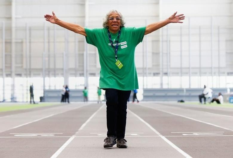 Ann Bing, 82, celebrates crossing the finish line during the track and field portion of the Brooklyn Senior Games at Ocean Breeze Athletic Complex in the Staten Island borough of New York, U.S., May 12, 2016. REUTERS/Shannon Stapleton