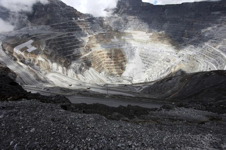 Trucks operate in the open-pit mine of PT Freeport's Grasberg copper and gold mine complex near Timika, in the eastern region of Papua, Indonesia on September 19, 2015 in this photo taken by Antara Foto. REUTERS/Muhammad Adimaja/Antara Foto/File Photo