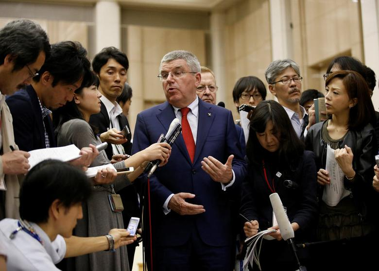President of the International Olympic Committee Thomas Bach (C) talks to reporters after meeting Tokyo governor Yuriko Koike at Tokyo Metropolitan Government Building in Tokyo, Japan, October 18, 2016.   REUTERS/Kim Kyung-Hoon