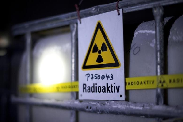 A radiation sign is attached to a barrel containing radioactive water during the visit of German Environment Minister Barbara Hendricks (not pictured) to the Asse nuclear waste disposal centre in a unused mine near the German village of Remlingen March 4, 2014. REUTERS/Jochen Luebke/Pool (GERMANY  - Tags: POLITICS SCIENCE TECHNOLOGY)   - RTR3G0ZO