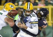 Oct 20, 2016; Green Bay, WI, USA; Green Bay Packers quarterback Aaron Rodgers (12) fumbles the ball after getting sacked by Chicago Bears linebacker Leonard Floyd (94) in the third quarter at Lambeau Field. Floyd recovered the fumble for a touchdown. Mandatory Credit: Benny Sieu-USA TODAY Sports