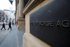 The plaque of the Deutsche Boerse AG is pictured at the entrance of the Frankfurt stock exchange February 1, 2012. REUTERS/Alex Domanski/File Photo