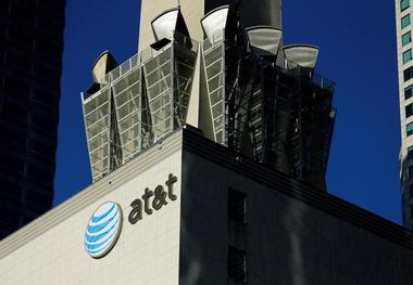 An AT&T logo and communication equipment is shown on a building in Los...