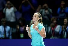 Tennis - Singapore WTA Finals Round Robin Singles - National Indoor Stadium, Singapore - 24/10/2016 - Svetlana Kuznetsova of Russia celebrates after defeating Agnieszka Radwanska of Poland.  REUTERS/Edgar Su