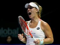 Tennis - Singapore WTA Finals Round Robin Singles - Singapore Indoor Stadium, Singapore - 25/10/2016 - Angelique Kerber of Germany celebrates a point against Simona Halep of Romania   REUTERS/Edgar Su