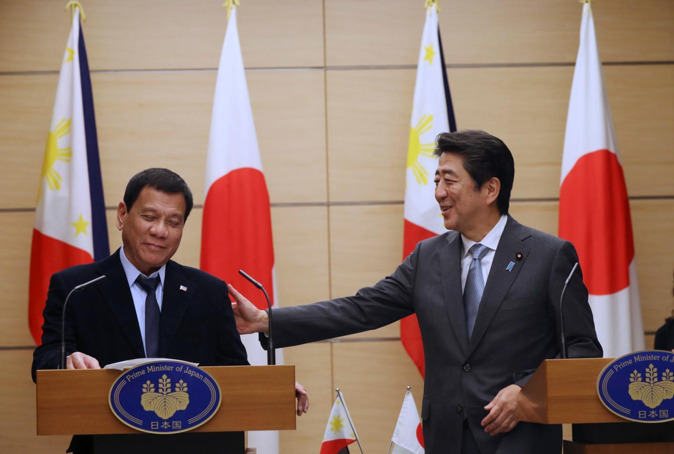 Philippines' Duterte tells Japan his China visit was just...