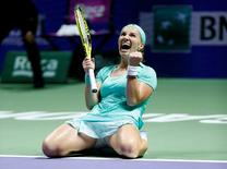 Tennis - Singapore WTA Finals Round Robin Singles - Singapore Indoor Stadium, Singapore - 26/10/2016 - Svetlana Kuznetsova of Russia celebrates after defeating Karolina Pliskova of Czech Republic. REUTERS/Edgar Su
