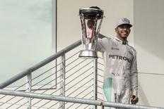 Oct 23, 2016; Austin, TX, USA; Mercedes driver Lewis Hamilton (44) of Great Britain holds up the trophy for the crowd after he wins the United States Grand Prix at the Circuit of the Americas. Mandatory Credit: Jerome Miron-USA TODAY Sports - RTX2Q4KX