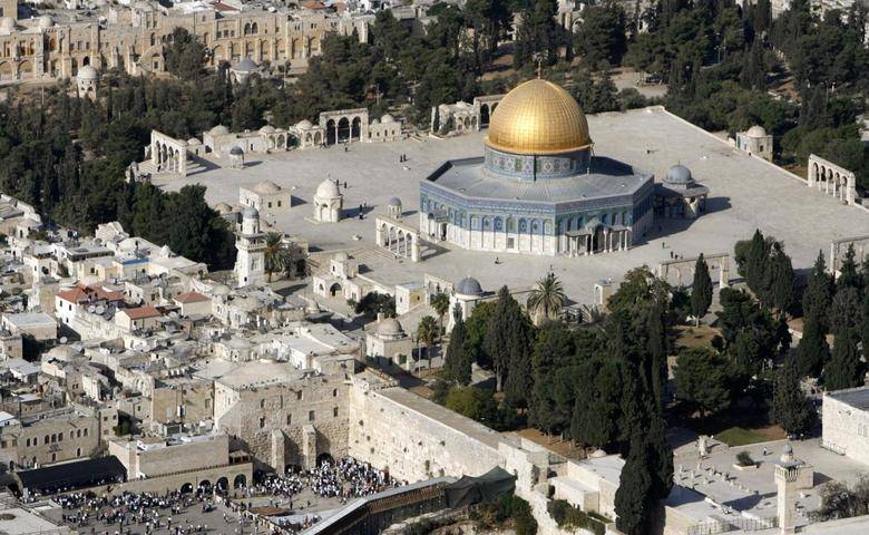 An aerial view shows the Dome of the Rock (R) on the compound known to Muslims as the Noble Sanctuary and to Jews as Temple Mount, and the Western Wall (L) in Jerusalem