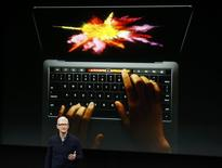 Apple CEO Tim Cook speaks under a graphic of the new MacBook Pro during an Apple media event in Cupertino, California, U.S. October 27, 2016.    REUTERS/Beck Diefenbach